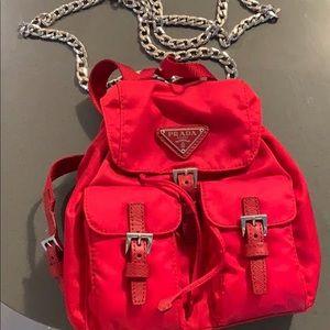 Mini red Prada backpack crossbody